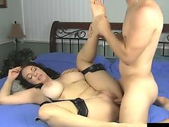 Blindfolded brunette gets her pussy smashed in a bed
