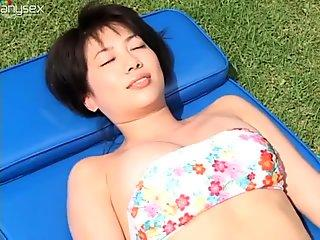Shameless brunette Asian Makoto Ishikawa receives massage outdoors