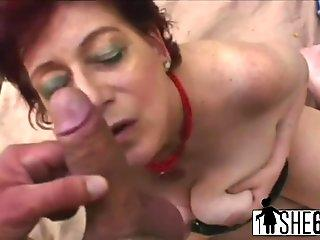 A slutty chubby redhead granny rubs her vagina then blows man s stiff penis