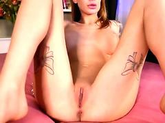 Sexy busty babe fingering her bald pussy and sucking dildo