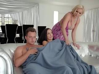 One busty blonde one hot brunette and a hard cock for a perfect threesome