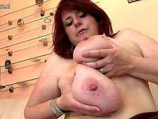 black-haired with massive knockers toy fucks her wet cunt