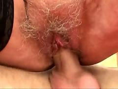 Hairy-pussy granny in stockings rides stranger's cock