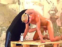 Blindfolded submissive guy receives handy action from master