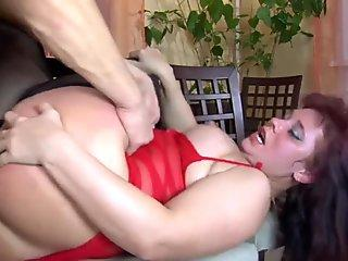 She strokes his cock until he cums