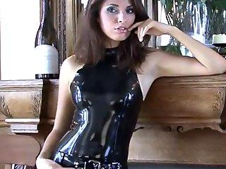 shining black latex outfit and fetishwear of spectacular cougar Olivia posing in taut pl