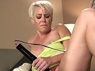Solo blonde Milf fucks machine in the sofa
