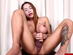 Bigtitted ladyboy wanking after showing off