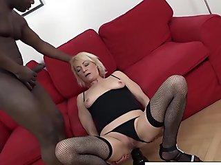 Blonde mature in fishnets gets her ass filled with cum