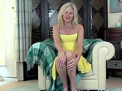 Ellen B gets bare on her white armchair