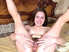 Sharon Rosie masturbates with her toy in bed