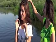 Cute schoolgirls playing in river