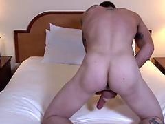 Soldier stud jerking his cock before cumshot