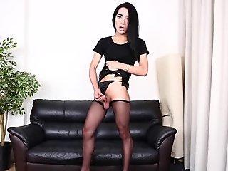 Stunning ladyboy tugging on her cock