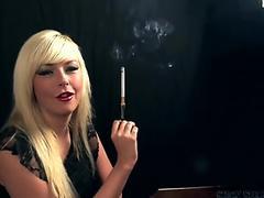 Morgan Lees smokes with a cigarette proprietor