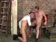 BDSM slave gagging on massive maledom cock