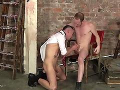 BDSM slave gagging on massive maledom cock