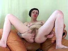 Margo Portman finger fucking her hairy pussy deeply