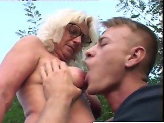 ash-blonde grandma gets some jizm on her glasses