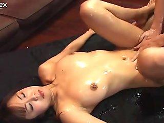 Oiled up Japanese trollop Maki Hoshino gets tit fucked and then bounces on a cock intensively