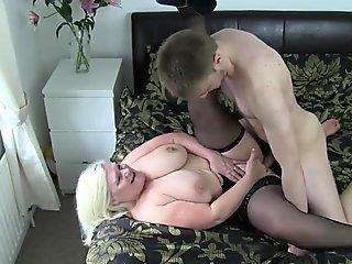 Busty granny gobbles dick