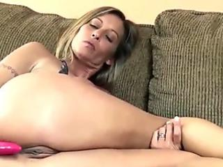 Mature slut Leeanna Heart raises her miniskirt to pound a dildo