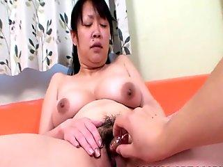 Asian honey with short haired sucks dick while getting her pussy teased