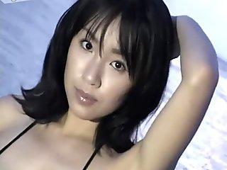 WEird looking but sexy Megumi Kagurazaka poses in her bright bikini